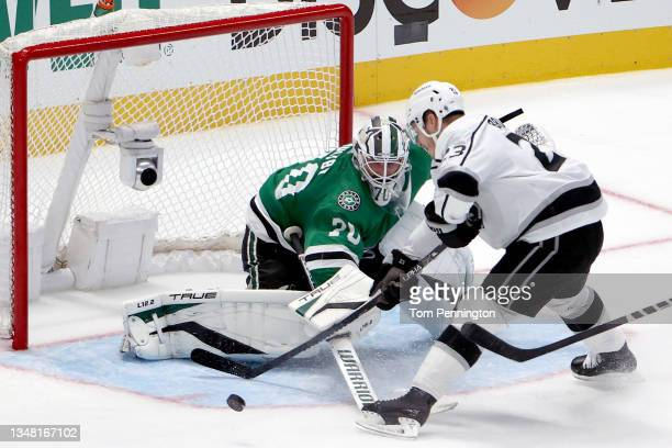 Braden Holtby of the Dallas Stars blocks a shot on goal against Dustin Brown of the Los Angeles Kings in the overtime period at American Airlines...