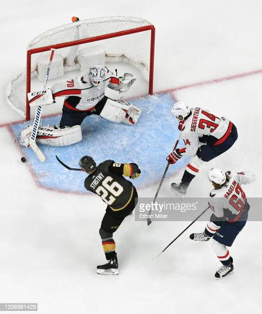 Braden Holtby of the Washington Capitals blocks a shot by Paul Stastny of the Vegas Golden Knights as Carl Hagelin and Jonas Siegenthaler of the...