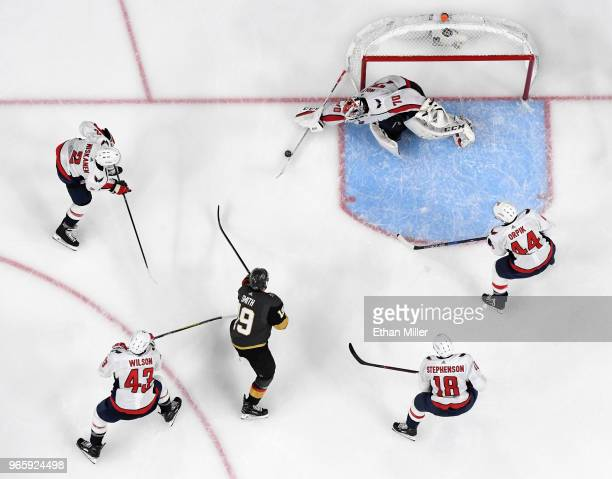 Braden Holtby of the Washington Capitals blocks a shot by Reilly Smith of the Vegas Golden Knights as Matt Niskanen Brooks Orpik Tom Wilson and...