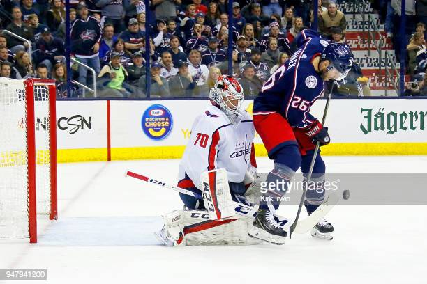 Braden Holtby of the Washington Capitals blocks a shot by Thomas Vanek of the Columbus Blue Jackets during the second period in Game Three of the...