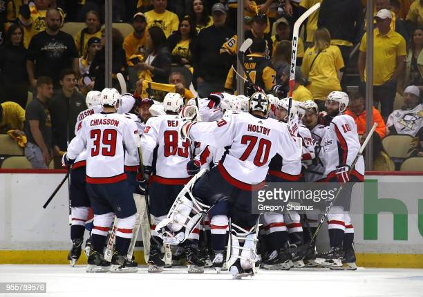Braden Holtby of the Washington Capitals celebrates a 21 overtime win over the Pittsburgh Penguins with teammates in Game Six of the Eastern...