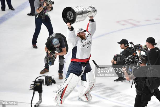 Braden Holtby of the Washington Capitals celebrates with the Stanley Cup after defeating the Vegas Golden Knights in Game Five of the Stanley Cup...