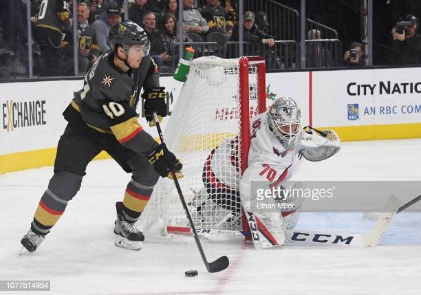 Braden Holtby of the Washington Capitals defends the net against Ryan Carpenter of the Vegas Golden Knights in the second period of their game at...