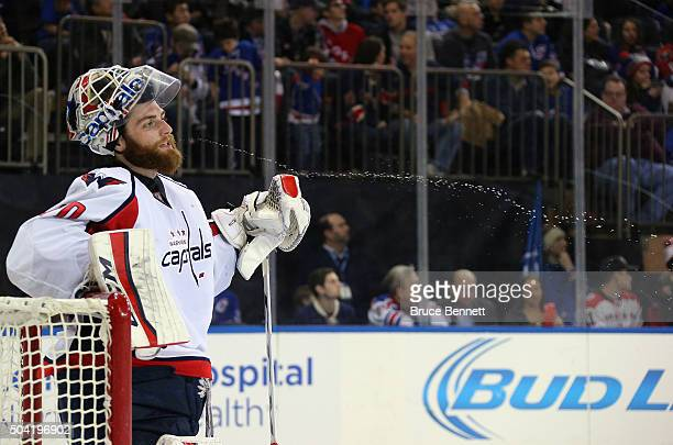 Braden Holtby of the Washington Capitals expels water during the second period against the New York Rangers at Madison Square Garden on January 9...