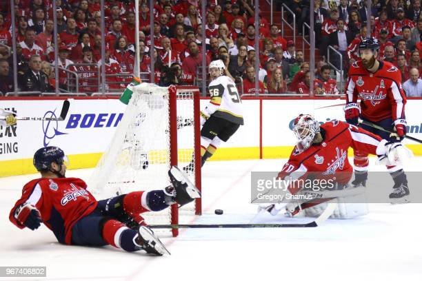 Braden Holtby of the Washington Capitals grabs the puck after it hit the post against the Vegas Golden Knights during the first period in Game Four...