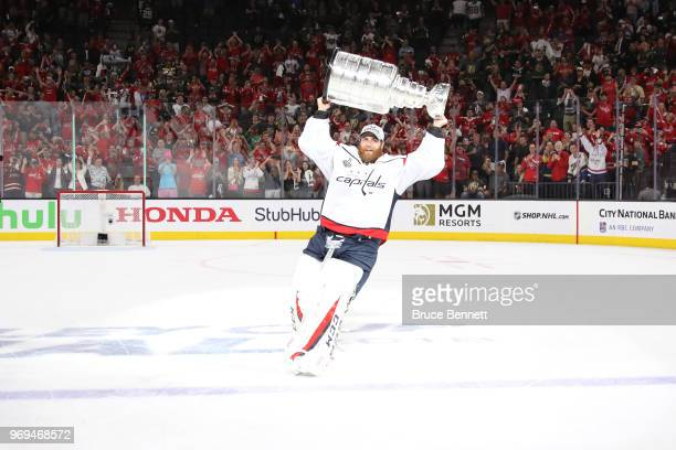 Braden Holtby of the Washington Capitals hoists the Stanley Cup after his team defeated the Vegas Golden Knights 43 in Game Five of the 2018 NHL...