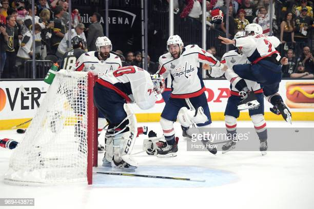 Braden Holtby of the Washington Capitals is congratulated by his teammates after their 43 win over the Vegas Golden Knights to win the Stanley Cup in...