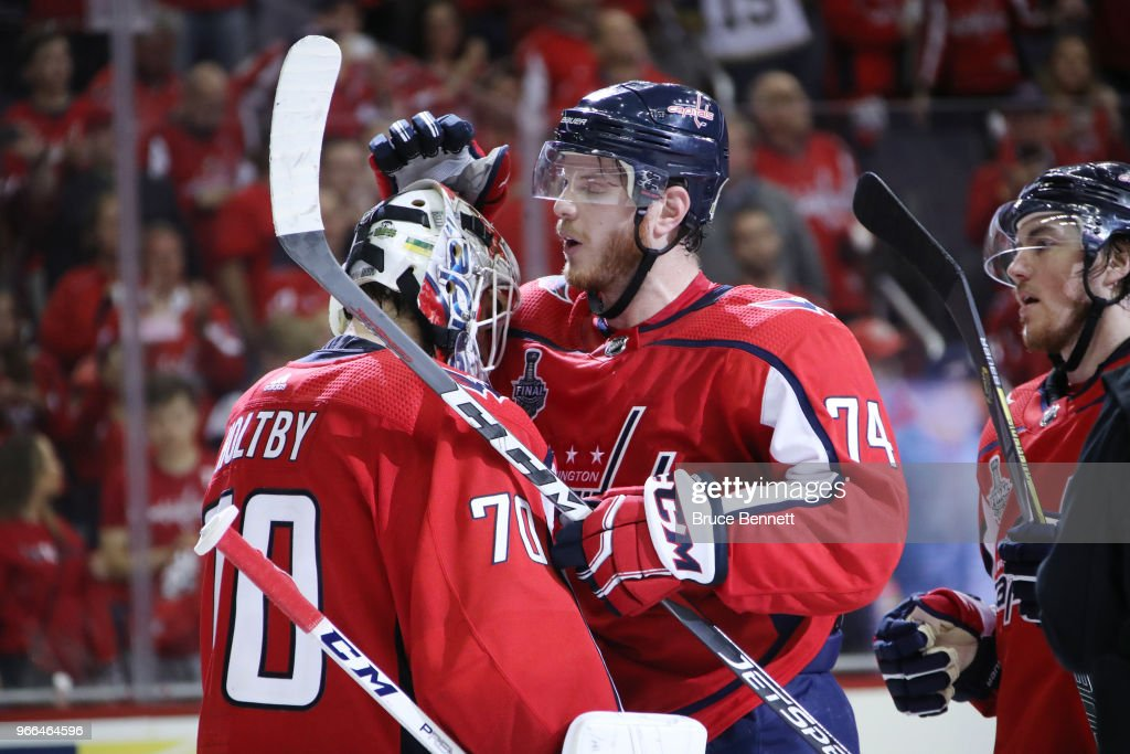 Braden Holtby #70 of the Washington Capitals is congratulated by teammate John Carlson #74 after defeating the Vegas Golden Knights in Game Three of the 2018 NHL Stanley Cup Final at Capital One Arena on June 2, 2018 in Washington, DC. The Capitals defeated the Golden Knights 3-1.