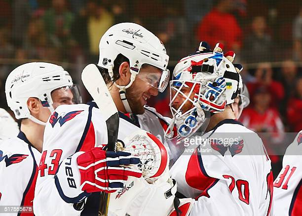 Braden Holtby of the Washington Capitals is congratulated by Tom Wilson after defeating the New Jersey Devils 10 in overtime during the game at the...