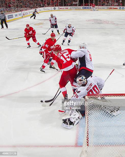 Braden Holtby of the Washington Capitals looks for the puck as teammate Dmitry Orlov battles with Riley Sheahan of the Detroit Red Wings during an...
