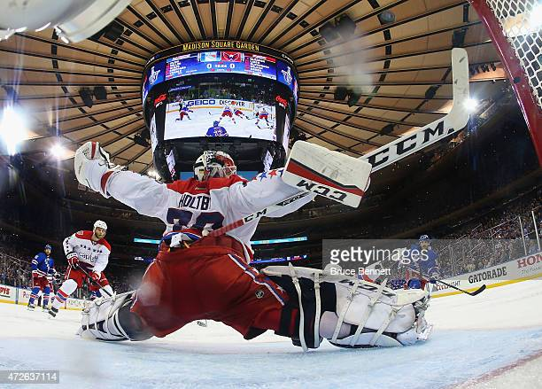 Braden Holtby of the Washington Capitals make sthe second period save on Derick Brassard of the New York Rangers in Game Five of the Eastern...
