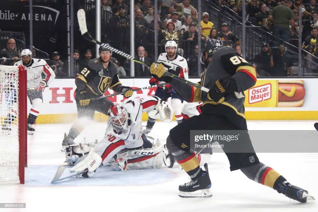 Braden Holtby #70 of the Washington Capitals makes a diving stick save on Alex Tuch #89 of the Vegas Golden Knights during the third period in Game Two of the 2018 NHL Stanley Cup Final at T-Mobile Arena on May 30, 2018 in Las Vegas, Nevada.