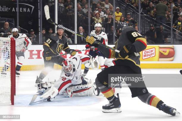 Braden Holtby of the Washington Capitals makes a diving stick save on Alex Tuch of the Vegas Golden Knights during the third period in Game Two of...