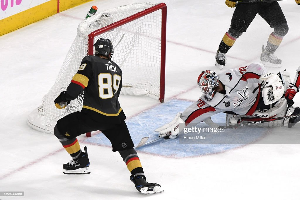 Braden Holtby #70 of the Washington Capitals makes a diving stick save on a shot by Alex Tuch #89 of the Vegas Golden Knights during the third period in Game Two of the 2018 NHL Stanley Cup Final at T-Mobile Arena on May 30, 2018 in Las Vegas, Nevada. The Capitals defeated the Golden Knights 3-2.