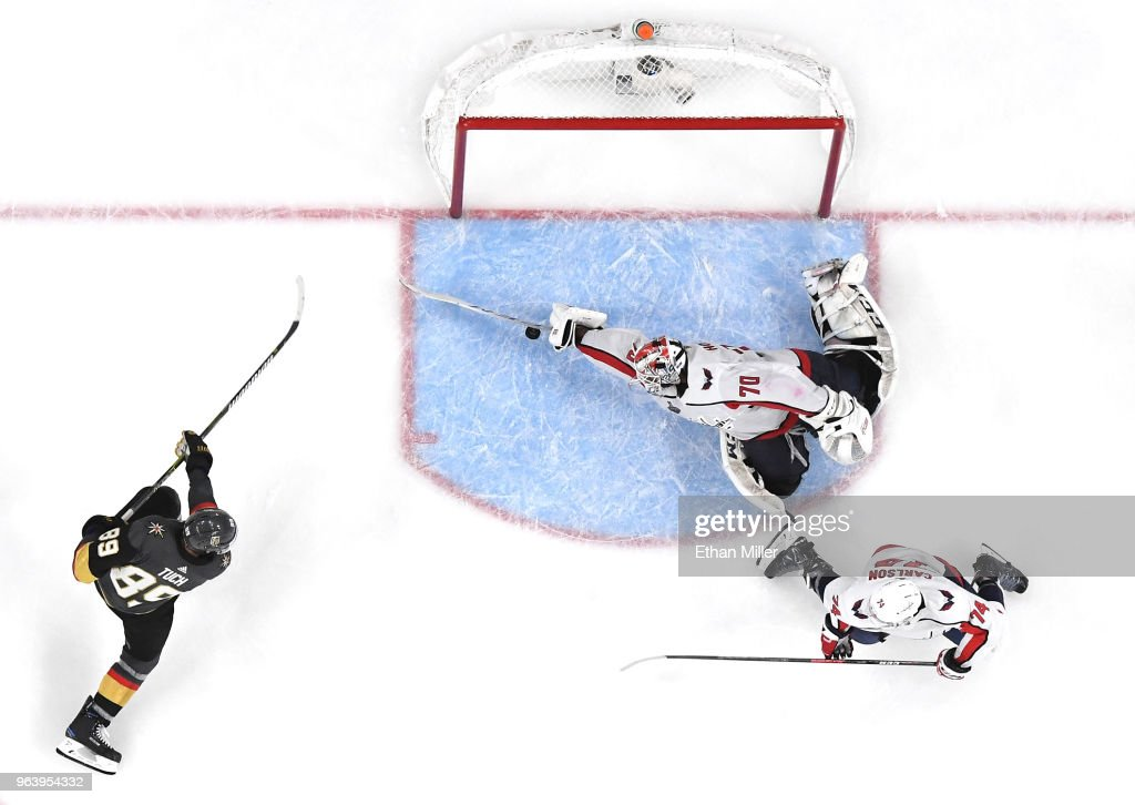 Braden Holtby #70 of the Washington Capitals makes a diving stick save on a shot by Alex Tuch #89 of the Vegas Golden Knights as John Carlson #74 of the Capitals defends in the third period of Game Two of the 2018 NHL Stanley Cup Final at T-Mobile Arena on May 30, 2018 in Las Vegas, Nevada. The Capitals defeated the Golden Knights 3-2.
