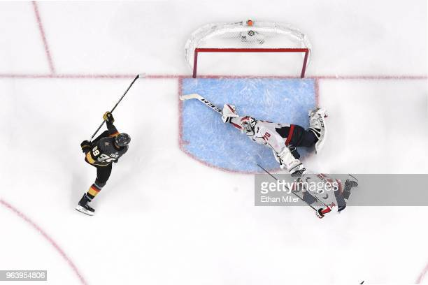 Braden Holtby of the Washington Capitals makes a diving stick save on a shot by Alex Tuch of the Vegas Golden Knights as John Carlson of the Capitals...