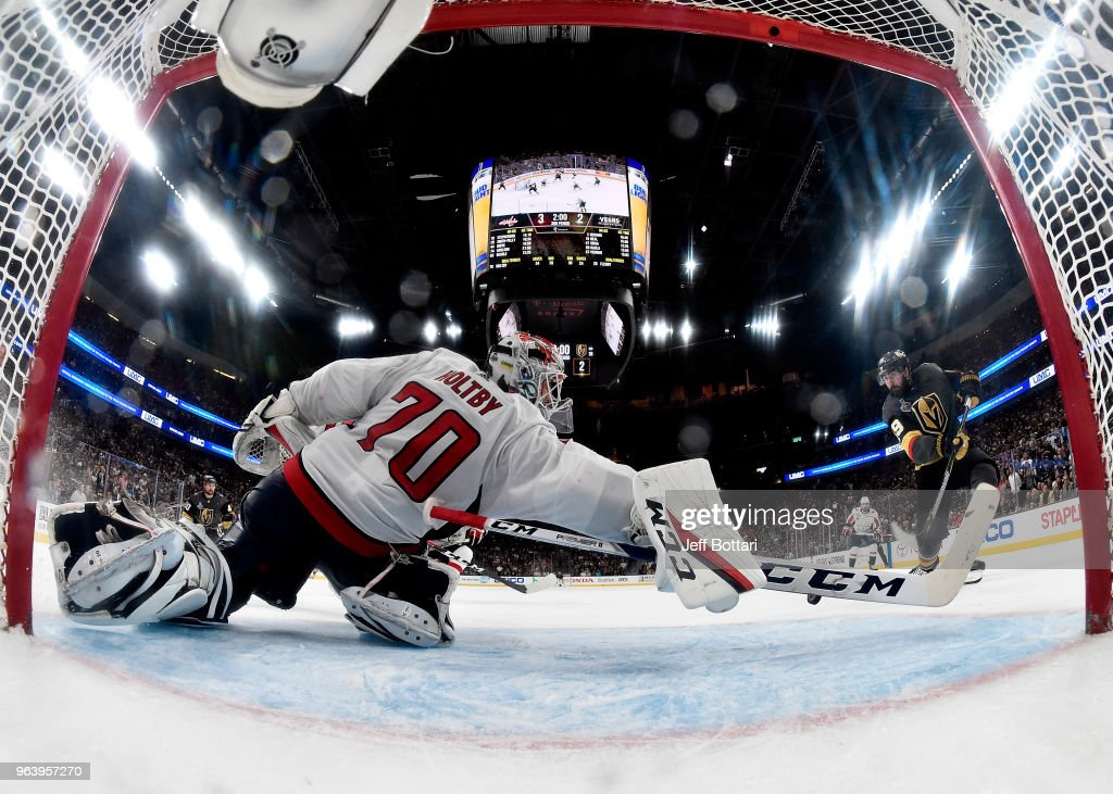 Braden Holtby #70 of the Washington Capitals makes a diving stick-save on Alex Tuch #89 of the Vegas Golden Knights during the third period in Game Two of the 2018 NHL Stanley Cup Final at T-Mobile Arena on May 30, 2018 in Las Vegas, Nevada. The Capitals defeated the Golden Knights3-2.
