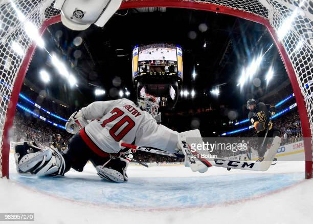 Braden Holtby of the Washington Capitals makes a diving sticksave on Alex Tuch of the Vegas Golden Knights during the third period in Game Two of the...