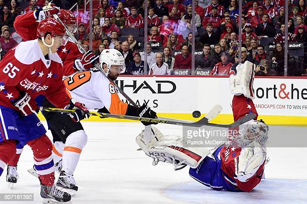 Braden Holtby of the Washington Capitals makes a save against Sam Gagner of the Philadelphia Flyers in the second period during their game at Verizon...