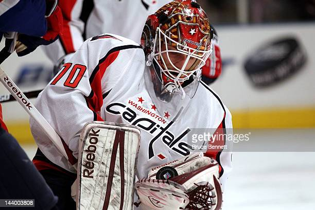Braden Holtby of the Washington Capitals makes a save against the New York Rangers in Game Five of the Eastern Conference Semifinals during the 2012...