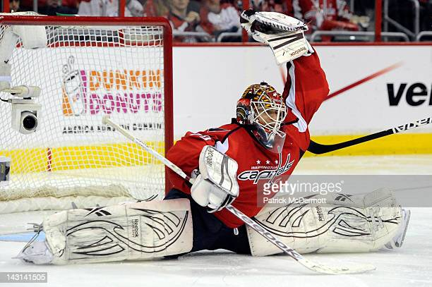 Braden Holtby of the Washington Capitals makes a save against the Boston Bruins in Game Four of the Eastern Conference Quarterfinals during the 2012...