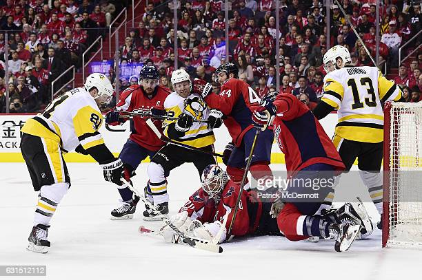 Braden Holtby of the Washington Capitals makes a save against the Pittsburgh Penguins in the second period during an NHL game at Verizon Center on...