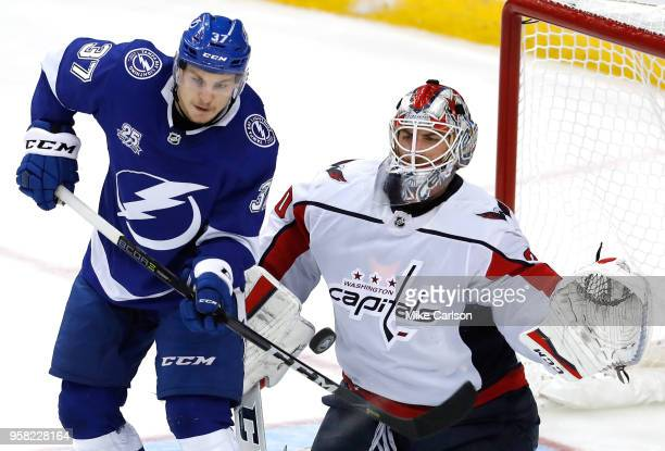 Braden Holtby of the Washington Capitals makes a save against Yanni Gourde of the Tampa Bay Lightning during the third period in Game Two of the...