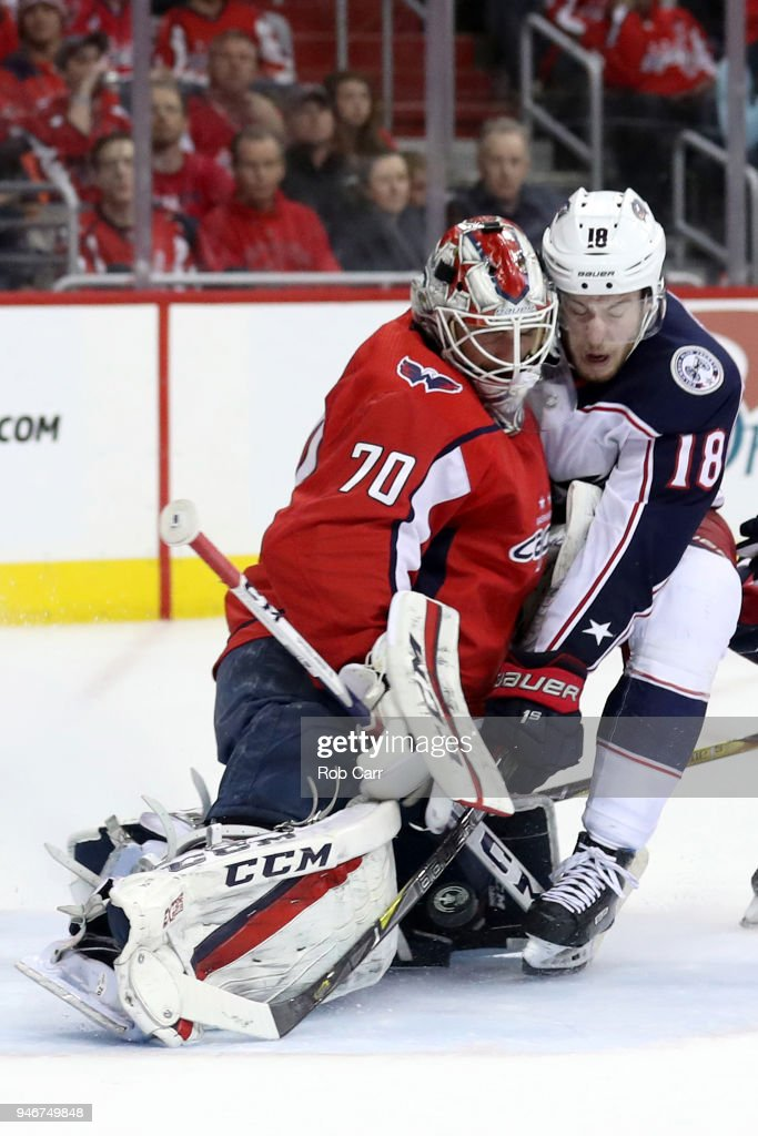 Braden Holtby #70 of the Washington Capitals makes a save on a shot by Pierre-Luc Dubois #18 of the Columbus Blue Jackets in the third period during Game Two of the Eastern Conference First Round during the 2018 NHL Stanley Cup Playoffs at Capital One Arena on April 15, 2018 in Washington, DC.