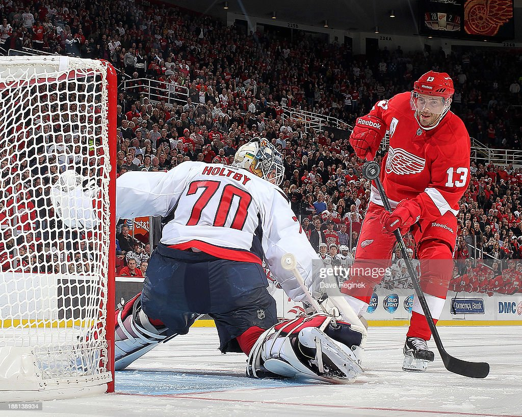 Braden Holtby #70 of the Washington Capitals makes a save on Pavel Datsyuk #13 of the Detroit Red Wings during a shootout in a NHL game at Joe Louis Arena on November 15, 2013 in Detroit, Michigan. The Capitals defeated the Wings 4-3 in a shootout.