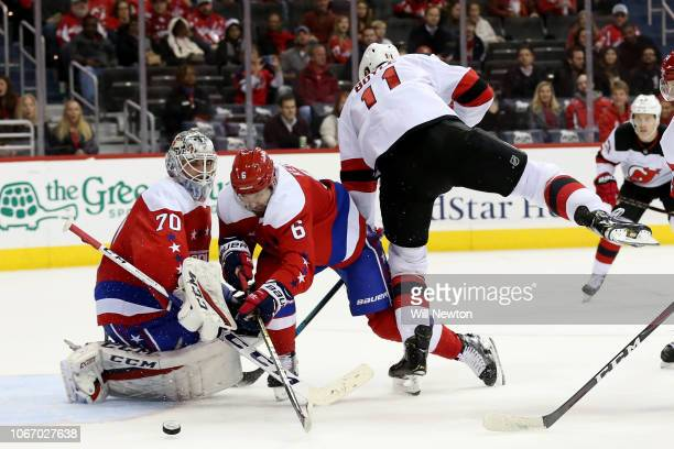 Braden Holtby of the Washington Capitals makes a save on the shot of Brian Boyle of the New Jersey Devils during the third period at Capital One...