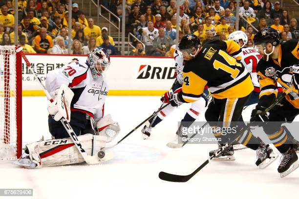 Braden Holtby of the Washington Capitals makes a second period save on Chris Kunitz of the Pittsburgh Penguins in Game Three of the Eastern...