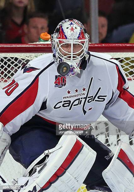 Braden Holtby of the Washington Capitals maves a save against the Chicago Blackhawks at the United Center on November 7 2014 in Chicago Illinois The...