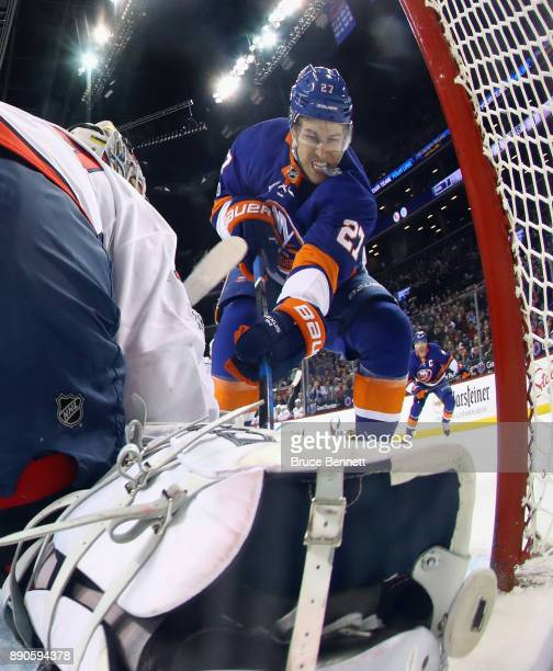 Braden Holtby of the Washington Capitals moves across the crease to stop a first period attempt by Anders Lee of the New York Islanders at the...