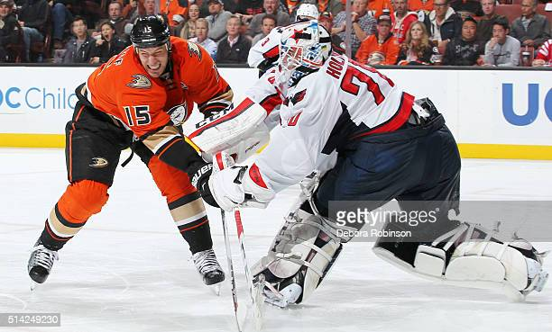 Braden Holtby of the Washington Capitals passes the puck while under pressure by Ryan Getzlaf of the Anaheim Ducks on March 7 2016 at Honda Center in...