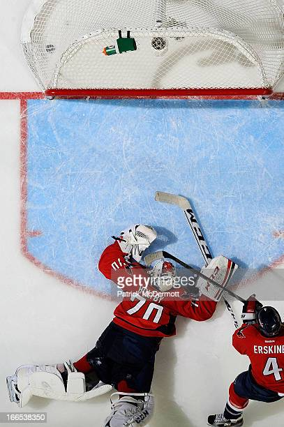 Braden Holtby of the Washington Capitals reacts after allowing the game tying goal in the third period of an NHL game against the Tampa Bay Lightning...