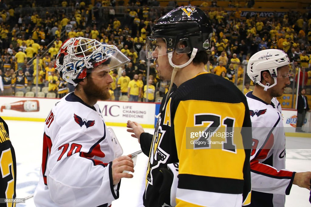 Braden Holtby #70 of the Washington Capitals shakes hands with Evgeni Malkin #71 of the Pittsburgh Penguins after a 4-2 series win in the Eastern Conference Second Round during the 2018 NHL Stanley Cup Playoffs at PPG Paints Arena on May 7, 2018 in Pittsburgh, Pennsylvania.