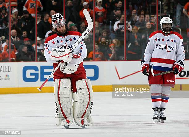 Braden Holtby of the Washington Capitals skates off the ice past teammate Joel Ward in the second period after being pulled and replaced by Philipp...