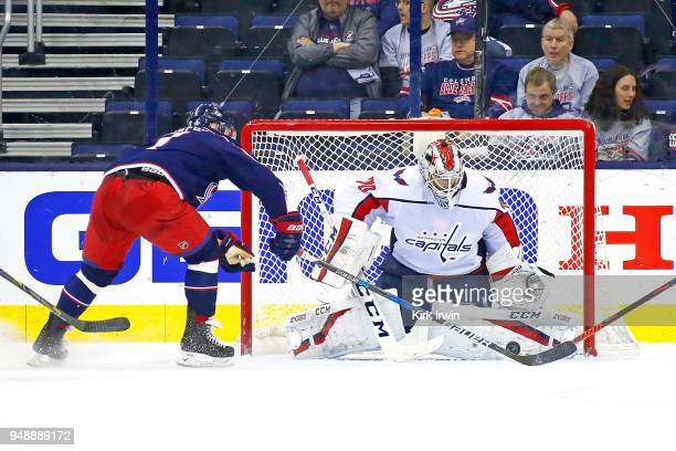 Braden Holtby of the Washington Capitals stops a shot from Brandon Dubinsky of the Columbus Blue Jackets during the third period in Game Four of the...