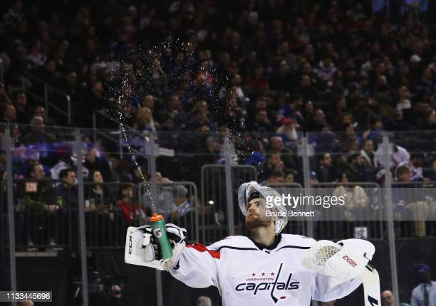 Braden Holtby of the Washington Capitals takes a second period water break during the game against the New York Rangers at Madison Square Garden on...