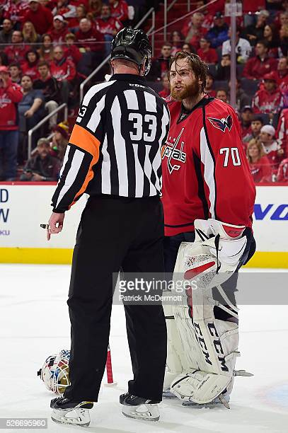 Braden Holtby of the Washington Capitals talks with referee Kevin Pollock after a play in the second period in Game Two of the Eastern Conference...