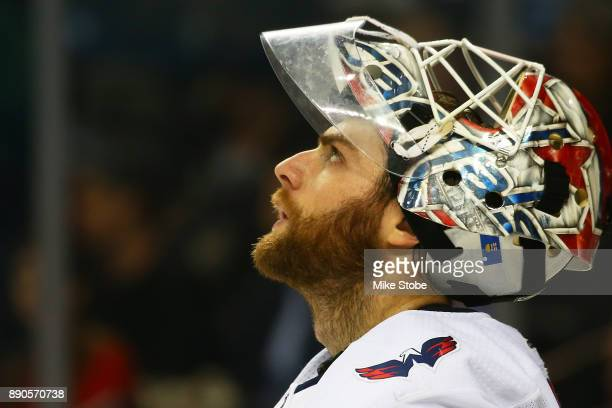 Braden Holtby of the Washington Capitals watches a replay during a stoppage in play against the New York Islanders at Barclays Center on December 11...