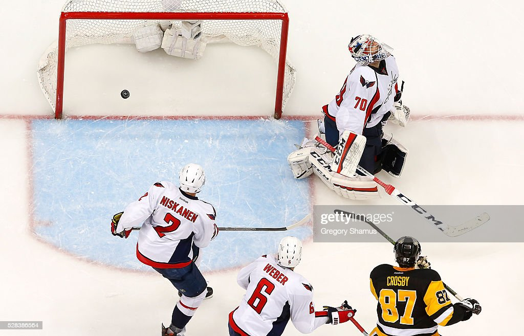 Braden Holtby #70 reacts after giving up the game winning goal to Patric Hornqvist #72 (not pictured) in front of Sidney Crosby #87 of the Pittsburgh Penguins in Game Four of the Eastern Conference Second Round during the 2016 NHL Stanley Cup Playoffs at Consol Energy Center on May 2, 2016 in Pittsburgh, Pennsylvania.