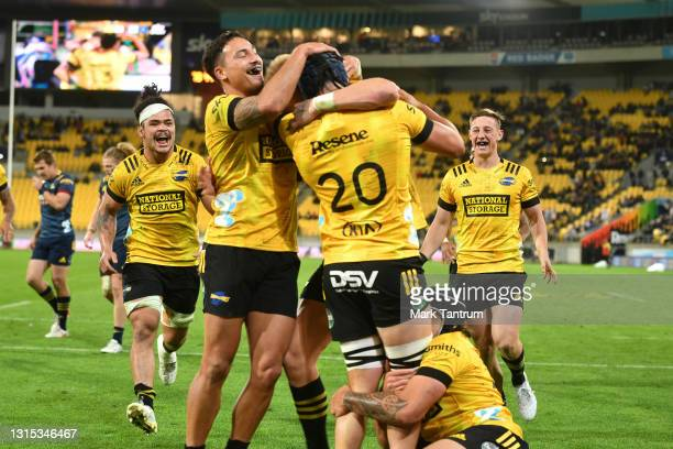 Braden Iose of the Hurricanes is congratulated after scoring during the round 10 Super Rugby Aotearoa match between the Hurricanes and the...