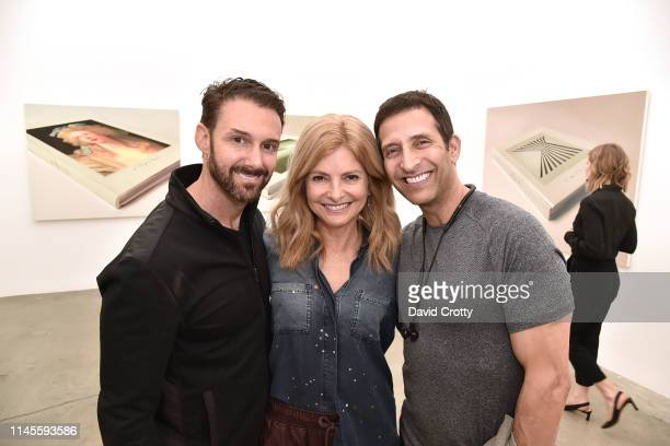 Braden Pollock Lisa Bloom and Roger Wolfson attend the opening of Robert Russell's Book Paintings exhibition at Anat Ebgi Gallery on April 27 2019 in...