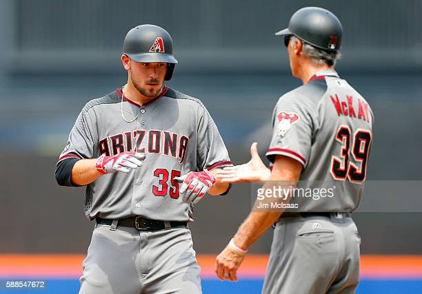 Braden Shipley of the Arizona Diamondbacks reacts after his fourth inning RBI single against the New York Mets with first base coach Dave McKay at...