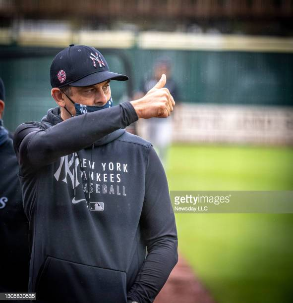 New York Yankees' manager Aaron Boone gives a thumbs up on field for his first game since getting a pacemaker at LECOM Park in Bradenton, Florida on...
