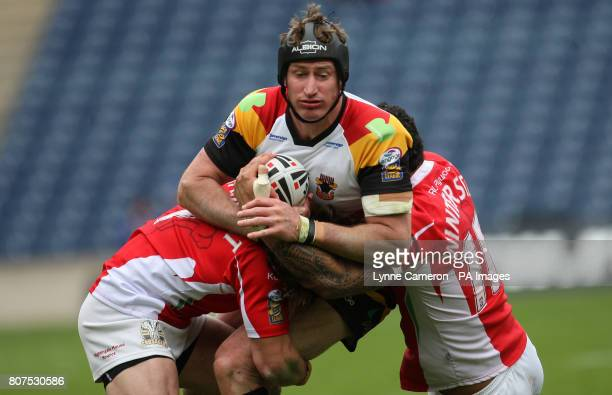 Bradford Bull's Elliott Whitehead and Crusaders RL's Frank Winterstein and Jarrod Sammut during the Engage Super League Match at Murrayfield