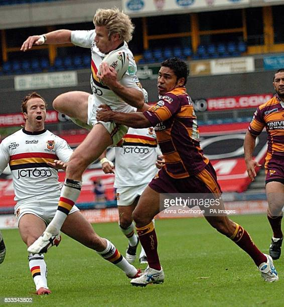 Bradford Bulls' Glenn Morrison catches the ball mid air under pressure from Huddersfield Giants' Rod Jensen during the Engage Super League match at...