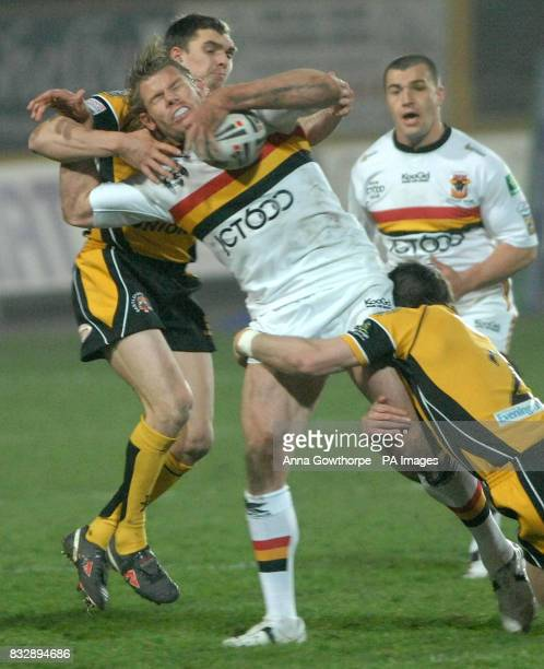 Bradford Bulls' Glenn Morrison tackled by Castleford Tiger's Danny Brough and Stuart Donlan during the Carnegie Challenge Cup fourth round match at...