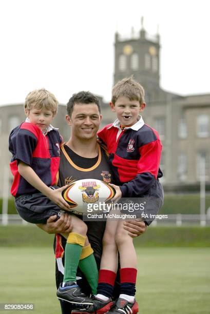 Bradford Bulls star Robbie Paul with pupils Andrew McCabe and Jack Barrett at Blackrock College where the Bulls coached the students and took part in...